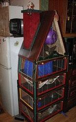 Клетки и домики для домашних животных и птиц
